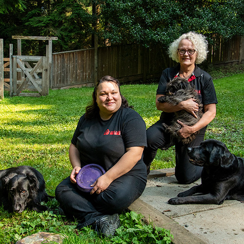 Karen and Carey with their dogs at the Bowen Island Dog Ranch.